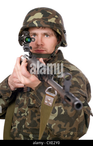 Soldier keeping a rifle - Stock Photo