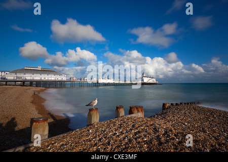 Pebble beach and pier, Eastbourne, East Sussex, England - Stock Photo