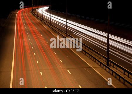 Light trails on M25 motorway at night, near London, England, UK, Europe.