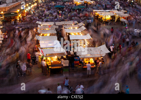 Long exposure, people moving around Djemaa El Fna, Marrakech, Morocco, North Africa, Africa - Stock Photo