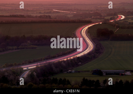 Telephoto aerial view of light trails at dusk on M40 motorway in The Chilterns, Oxfordshire, England, United Kingdom, - Stock Photo