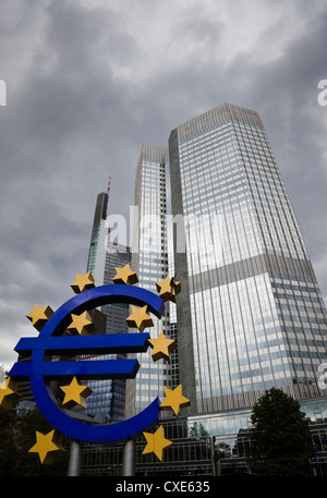 Euro sculpture in front of the Eurotower, the European Central Bank Headquarters, Germany, Europe - Stock Photo