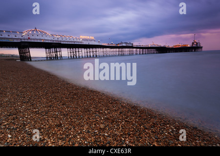 Looking out at Brighton Pier from Brighton beach, taken at sunset, Brighton, Sussex, England, United Kingdom, Europe - Stock Photo