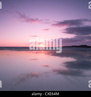 Sunset reflected in wet sand and sea on Crackington Haven Beach, Cornwall, England, United Kingdom, Europe - Stock Photo
