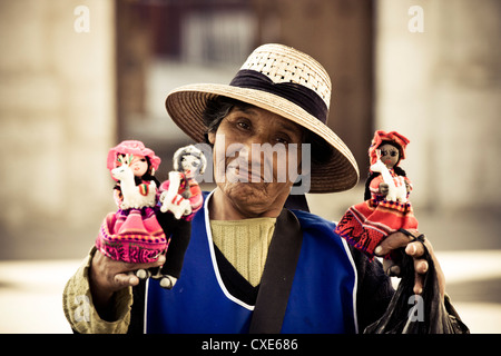 Woman selling hand-made dolls in Arequipa Plaza De Armas, Arequipa, Peru, South America - Stock Photo