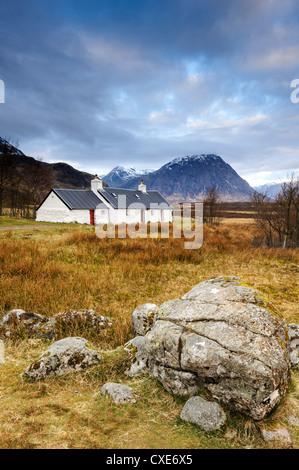 Black Rock Cottages and Buachaille Etive Mor, Rannoch Moor, Glencoe, Highland region, Scotland - Stock Photo