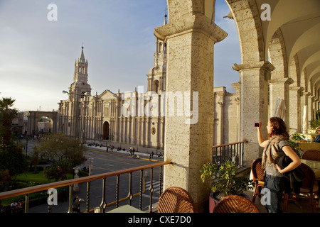 Woman taking photograph of Arequipa Cathedral (la catedral) Plaza de Armas, Arequipa, peru, South America - Stock Photo
