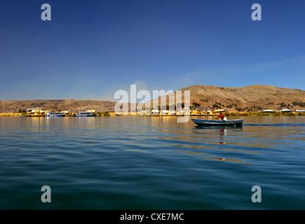 Rowing boat, Islas Flotantes, Lake Titicaca, Flotantes, peru, South America - Stock Photo