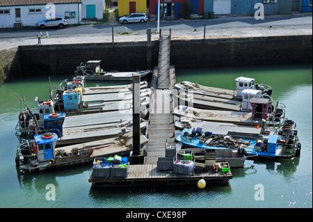 Oyster farming flat boats in the harbour at Le Château-d'Oléron on the island Ile d'Oléron, Charente-Maritime, France - Stock Photo