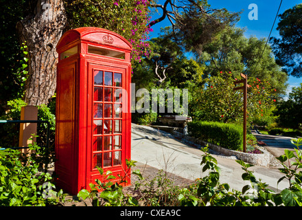 Red telephone box, Alameda Gardens, Gibraltar, Europe - Stock Photo