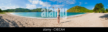Woman enjoying freedom at Mawun Beach, a tropical paradise in South Lombok, Indonesia, Southeast Asia, Asia - Stock Photo