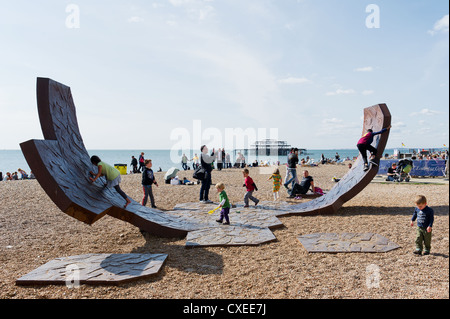 Children playing on the iron sculpture Passacaglia on Brighton beach