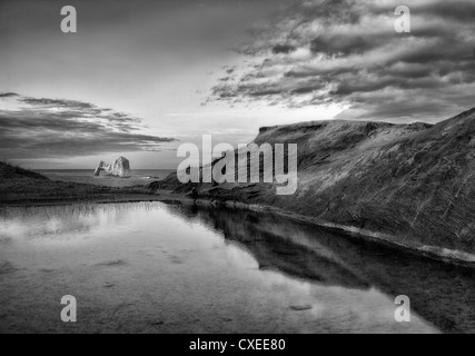 Mack Arch at sunrise and reflecting pool of water. Oregon - Stock Photo
