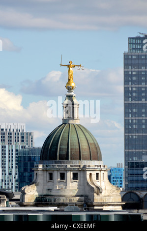London skyline Lady Justice statue or Scales of Justice at the top of the Old Bailey building at the Central Criminal - Stock Photo