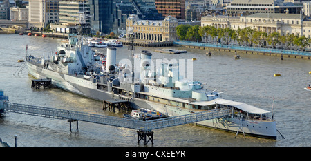 HMS Belfast originally a Royal Navy light cruiser permanently moored as part of Imperial War Museum River Thames - Stock Photo