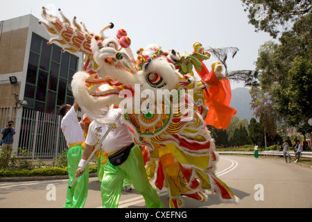 Traditional Chinese Dragon Dance on Lantau Island, Hong Kong, China - Stock Photo