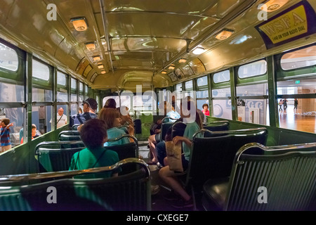 Tourists on the bus on which Rosa Parks refused to give up her seat, The Henry Ford Museum, Dearborn, Detroit, Michigan, - Stock Photo