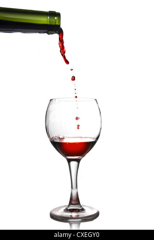 Pouring red wine in goblet Stock Photo