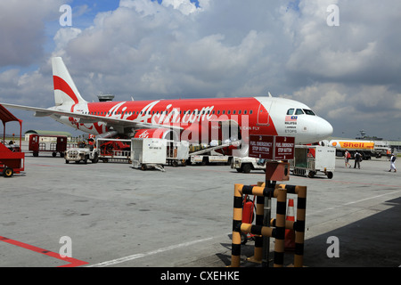 Air Asia Airbus jet airliner on the tarmac at LCCT airport in Malaysia. - Stock Photo