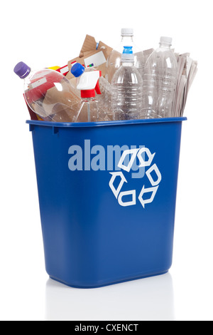 A blue recycling can with cardboard and plastic bottles on a white background - Stock Photo