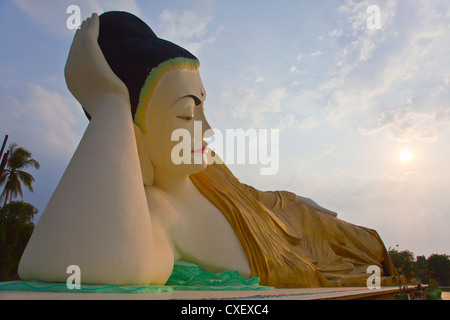 The MYA THA LYAUNG reclining BUDDHA is one of the largest in the world - BAGO, MYANMAR - Stock Photo