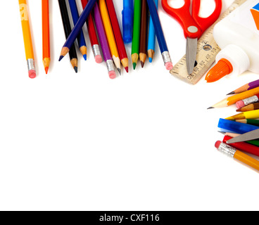border of school supplies on a white background with copy space - Stock Photo