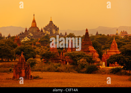 View from OAKKYAUNGGYI TEMPLE of ANANDA and THATBYINNYU TEMPLES and the plains of BAGAN - MYANMAR - Stock Photo