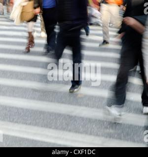 people crowd on zebra crossing street - Stock Photo
