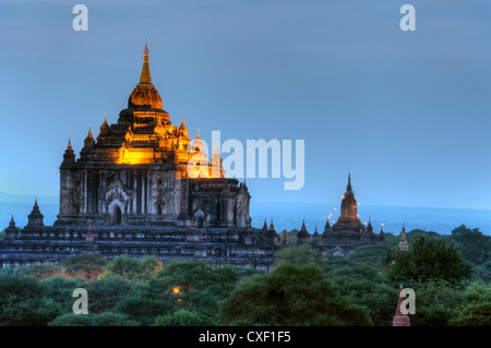 View of THE THATBYINNYU TEMPLE from the SHWESANDAW TEMPLE or PAYA at sunset - BAGAN, MYANMAR - Stock Photo