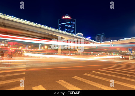 light trails on the viaduct in beijing - Stock Photo