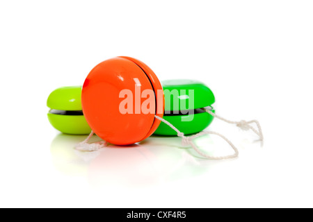 Colorful yo-yos on a white background - Stock Photo