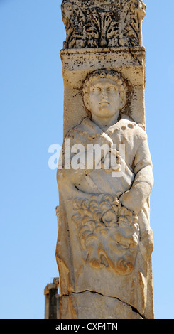Roman Column incorporating Corinthian capitol and the figure of Heracles at the  Hercules Gate, Archaeological Site, - Stock Photo