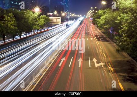 beijing night scene in rush hour traffic - Stock Photo