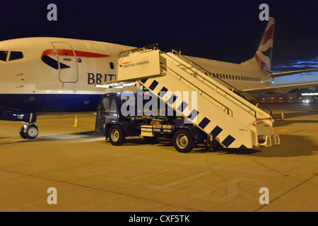 A set of mobile steps on a Boeing 737 at Gatwick - Stock Photo