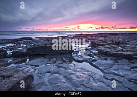 The rocky shoreline of Dunraven Bay at its northern end provides a wealth of geological fascination. - Stock Photo