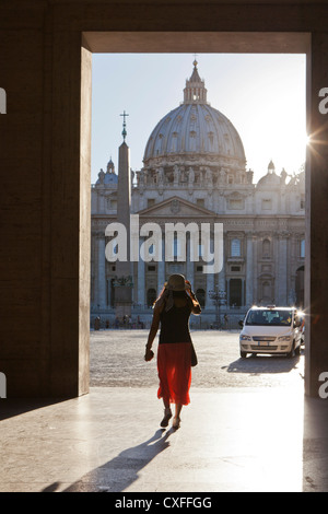 woman framed in front St Peters Basilica, Vatican, Rome. - Stock Photo