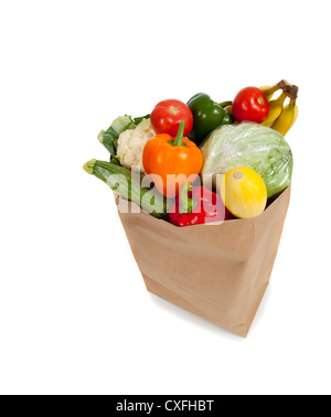 Brown paper grocery sack filled with produce - Stock Photo