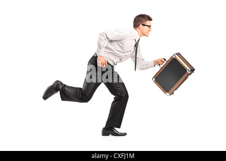 Young businessman running with a briefcase isolated against white background - Stock Photo