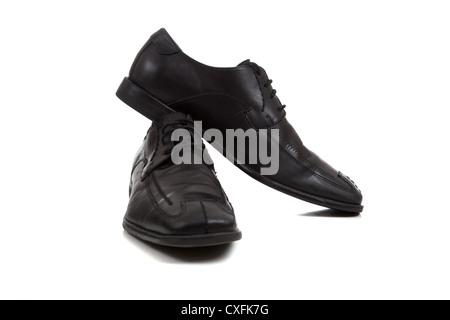 A pair of men's black dress shoes on a white background - Stock Photo