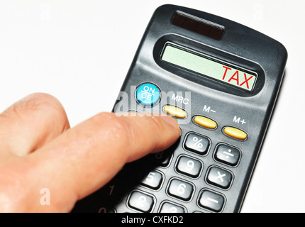 Tax word on calculator - Stock Photo