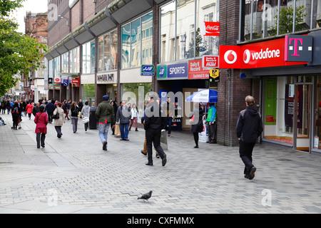 Pedestrians in Sauchiehall Street shopping precinct in Glasgow City Centre, Scotland, UK - Stock Photo