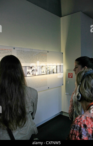 Young people read of what happened to Jews in Europe between 1933 and 1945 at the Jewish Memorial Centre in Berlin - Stock Photo