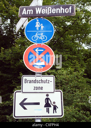 A road sign for a pedestrian zone, bike lane and no parking - Stock Photo