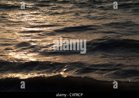 The Ocean of Patong Beach on Phuket during Sunset - Stock Photo