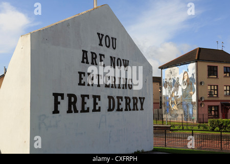 Street scene with Free Derry corner stone inscription and mural in Derry, Co Londonderry, Northern Ireland, UK - Stock Photo