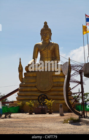 Golden Statue at the Temple of the Big Buddha on Phuket - Stock Photo