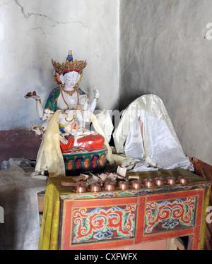 Shrine with offerings.   Namgyal Tsemo Gompa,  Leh, Ladakh, Republic of India.