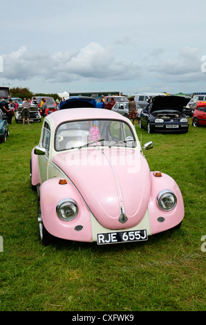 A pink Volkswagen Beetle at a rally in cornwall, uk - Stock Photo