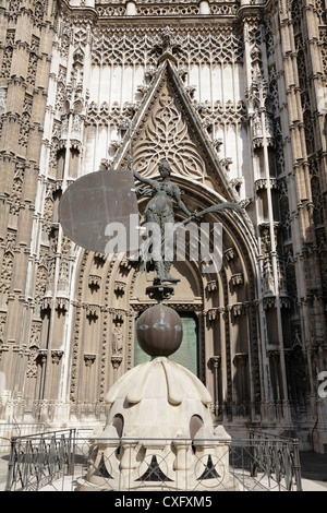 South facade of Seville Cathedral Door of Saint Cristopher at the south transept a replica of the 'Giraldillo' statue - Stock Photo