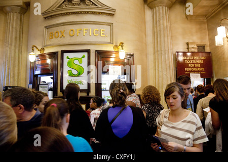 People coming to see Shrek the Musical in the Box Office of the Theatre Royal Drury Lane, West End London UK - Stock Photo